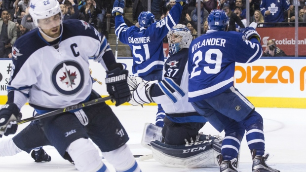 Winnipeg Jets goalie Connor Hellebuyck looks on after Toronto Maple Leafs' Jake Gardiner scored his team's game winning goal during overtime NHL hockey action, in Toronto on Tuesday, Feb. 21, 2017. (Chris Young / THE CANADIAN PRESS)