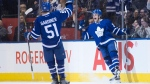Toronto Maple Leafs' William Nylander, right, celebrates with teammate Jake Gardiner after scoring his team's fourth goal during third period NHL hockey action against the Winnipeg Jets, in Toronto on Tuesday, February 21, 2017. THE CANADIAN PRESS/Chris Young