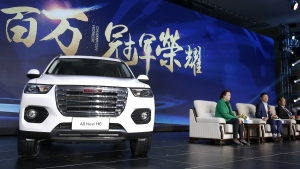 In this Sunday, Feb. 19, 2017 photo, Wei Jianjun, chairman of Great Wall Motors Ltd., second from right, speaks as a newly unveiled Haval SUV H6 model is displayed during a reception celebrating it sales passing the one million mark, at Great Wall headquarters in Baoding in north China's Hebei province. (AP / Andy Wong)