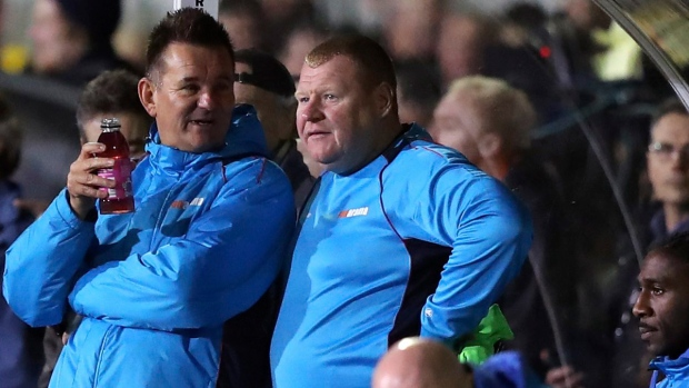 Sutton reserve goalkeeper Wayne Shaw, centre, and manager Paul Doswell during the FA Cup 5th round soccer match at Gander Green Lane, London, on Feb. 20, 2017. (Andrew Matthews / PA via AP)