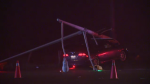 Crash Tuesday evening leaves car trapped under fallen pole and wires