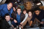 In this undated image provided by Lucasfilm, cast members and co-directors of the Han Solo 'Star Wars' spin-off pose for a photo, from bottom left, co-director Christopher Miller, Woody Harrelson, Phoebe Waller-Bridge, Alden Ehrenreich, Emilia Clarke, Joonas Suotamo as Chewbacca, co-director Phil Lord and Donald Glover. (Jonathan Olley/Lucasfilm via AP)