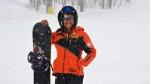 Azquiya Usuph of Sri Lanka posing with her snowboard at Sapporo Teine resort. (Julian LINDEN / AFP)