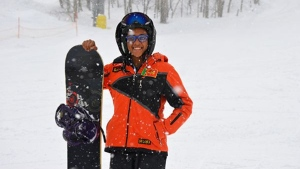 Azquiya Usuph of Sri Lanka posing with her snowboard at Sapporo Teine resort. (Julian LINDEN / AFP)