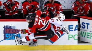 New Jersey Devils right wing Kyle Palmieri (21) checks Ottawa Senators right wing Curtis Lazar (27) during the third period of an NHL hockey game, Tuesday, Feb. 21, 2017, in Newark, N.J. The Senators won 2-1. (Julio Cortez/AP Photo)