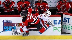 New Jersey Devils right wing Kyle Palmieri (21) checks Ottawa Senators right wing Curtis Lazar (27) during the third period of an NHL hockey game, Tuesday, Feb. 21, 2017, in Newark, N.J. The Senators won 2-1. (Julio Cortez/AP Photo)