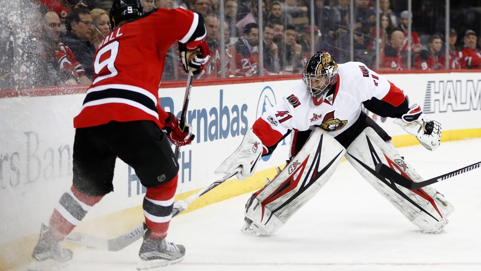 Ottawa Senators goalie Craig Anderson (41) leaves the crease to defend against New Jersey Devils left wing Taylor Hall (9) during the second period of an NHL hockey game, Tuesday, Feb. 21, 2017, in Newark, N.J. (Julio Cortez/AP Photo)