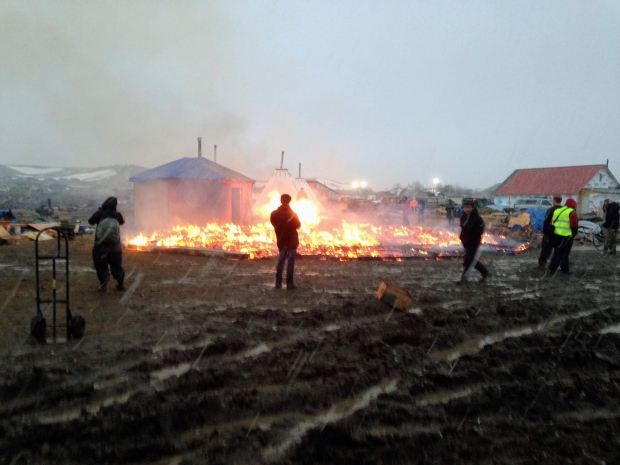 Dakota Access pipeline opponents burn structures in their main protest camp in southern North Dakota near Cannon Ball, N.D., on Wednesday, Feb. 22, 2017, as authorities prepare to shut down the camp in advance of spring flooding season. (AP Photo/James MacPherson)