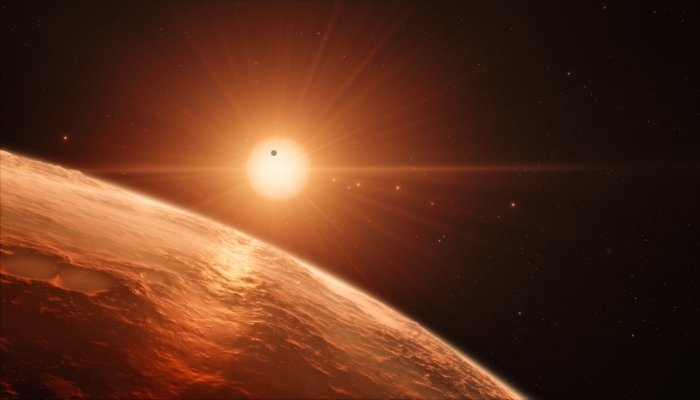 This artist's impression shows the view from the surface of one of the planets in the TRAPPIST-1 system. (M. Kornmesser / ESO)