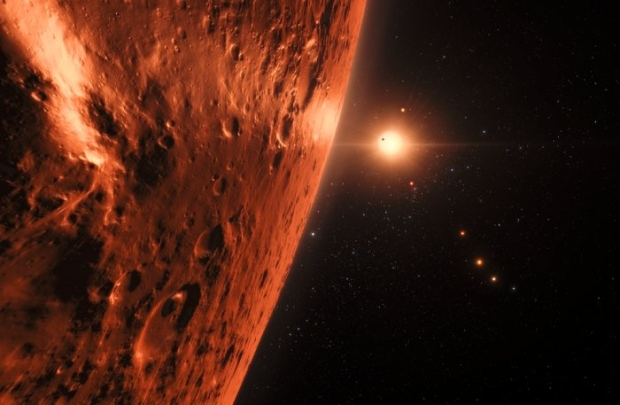 This artist's impression shows the view just above the surface of one of the planets in the TRAPPIST-1 system. (M. Kornmesser / ESO)