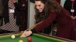 Princess Kate Duchess of Cambridge playing pool during her visit to Action for Children project MIST in Torfaen, Wales, on Feb. 22, 2017. (Paul Edwards/pool via AP)