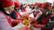 FILE - In this Oct. 28, 2015 file photo, housewives make kimchi, traditional pungent vegetable, to donate to needy neighbors for winter preparation at a government building in Seoul, South Korea. While most people born in rich countries will live longer by 2030, with women in South Korea projected to reach nearly 91, Americans will continue to have one of the lowest life expectancies of any developed country, a new study published online Tuesday, Feb. 21, 2017 predicts. (AP Photo/Ahn Young-joon, File)
