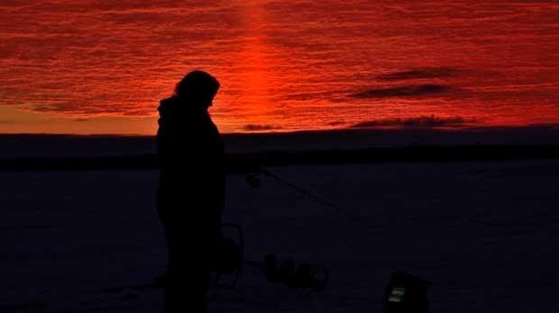 Early morning ice fishing on Lake Winnipeg. Photo by Mike Dotoli.