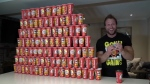 "Popular YouTube star, Pete Czerwinski, bought 100 empty cups to test the odds of winning a prize in Tim Hortons' ""Roll Up The Rim To Win"" contest. (Furious Pete / YouTube)"
