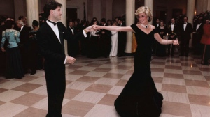 FILE - In this Nov. 9, 1985 photo provided by the Ronald Reagan Library, actor John Travolta dances with Princess Diana at a White House dinner in Washington. (Ronald Reagan Library via AP, File)