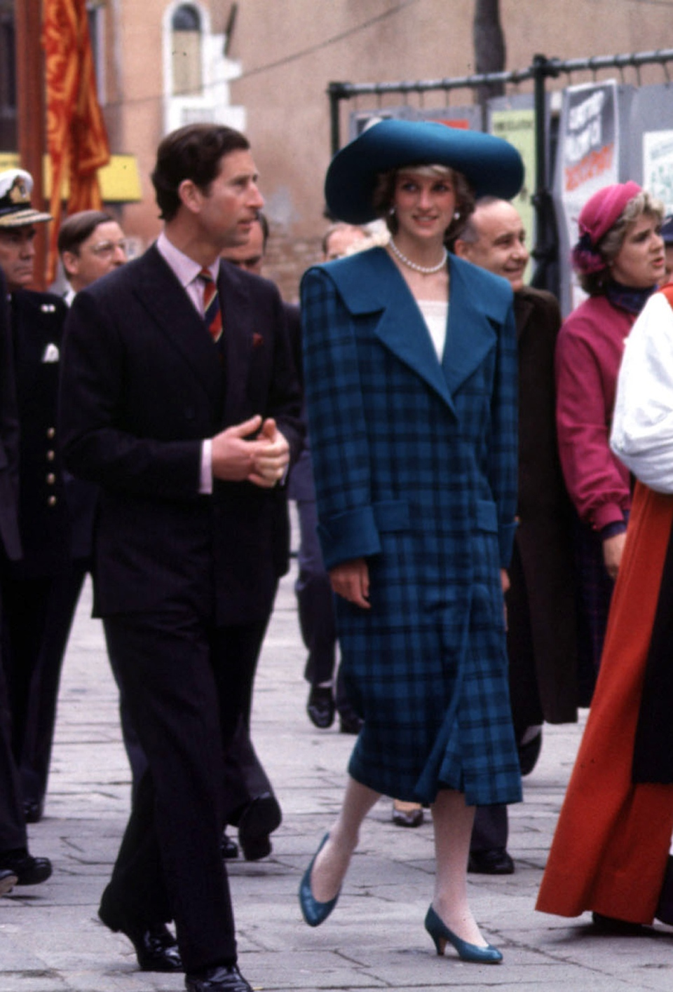 FILE - In this May 5, 1985 file photo, Diana, Princess of Wales wears a blue tartan Emanuel suit during an official visit to Venice, Italy, with Britain's Prince Chalres. (/PA via AP)