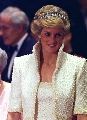 FILE - In this 1989 file photo, Diana, Princess of Wales smiles during an official visit to Hong Kong. (AP Photo/Liu Heung Shing, file)
