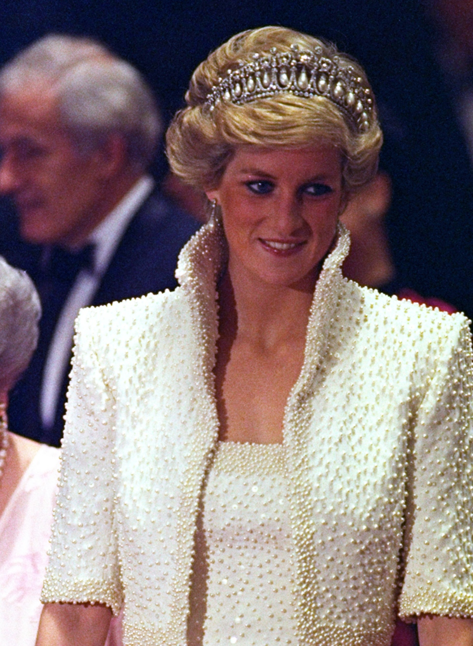 FILE - In this 1989 file photo, Diana, Princess of Wales smiles during an official visit to Hong Kong. (AP Photo/Liu Heung Shing, file)