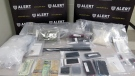 Drugs, cell phones and cash seized during the February 20 searches of an SUV on Highway 3 and a Lethbridge home (courtesy: ALERT)