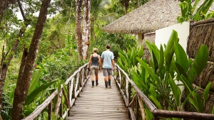 This undated photo shows visitors walking down a path at the Lapa Rios Lodge in Costa Rica. (Lapa Rios Lodge via AP)