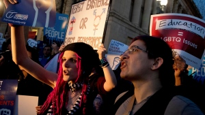 Activists and protesters with the National Center for Transgender Equality rally in front of the White House, Wednesday, Feb. 22, 2017, in Washington, after the Department of Education and the Justice Department announce plans to overturn the school guidance on protecting transgender students. (AP / Andrew Harnik)