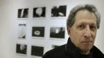Photographer Karl Baden, of Cambridge, Mass., stands for a photo in front of an exhibit of his photographs from 1976 called 'Thermographs,' at the Miller Yezerski Gallery, in Boston on Wednesday, Feb. 22, 2017. (AP / Steven Senne)
