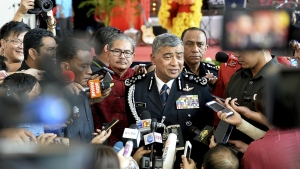 Malaysia's National Police Inspector-General Khalid Abu Bakar, centre, is surrounded by journalists in Kuala Lumpur, Malaysia on Thursday, Feb. 23, 2017. (AP)