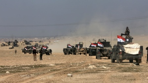 Iraqi special forces advance towards the western side of Mosul, Iraq on Thursday, Feb. 23, 2017. (AP / Khalid Mohammed)