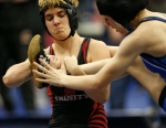 In this Feb. 18, 2017 photo, Euless Trinity's Mack Beggs, left, wrestles Grand Prairie's Kailyn Clay during the finals of the UIL Region 2-6A wrestling tournament at Allen High School in Allen, Texas. (Nathan Hunsinger/The Dallas Morning News via AP)