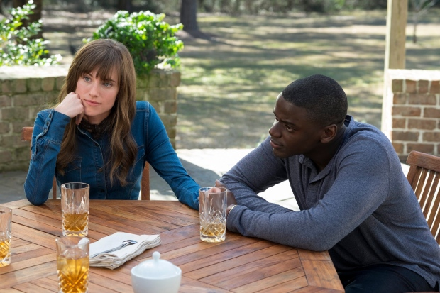 This image released by Universal Pictures shows Allison Williams, left, and Daniel Kaluuya in a scene from, 'Get Out.' (Justin Lubin / Universal Pictures)
