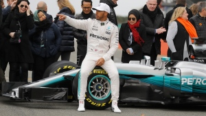Mercedes driver Lewis Hamilton poses for photographers at the launch of the new Mercedes F1 car at the Silverstone racetrack in Towcester, England, on Feb. 23, 2017. (Frank Augstein / AP)
