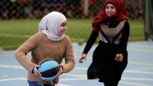 Syrian refugee girls play a basketball game at a private sports club in Beirut, Lebanon, on Feb. 19, 2017. (Hussein Malla / AP)