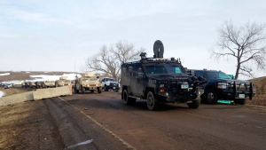 Law enforcement vehicles arrive at the closed Dakota Access pipeline protest camp near Cannon Ball, N.D., on Feb. 23, 2017. (James MacPherson / AP)