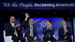 Kansas Gov. Sam Brownback, second from left, waves as he is introduced for a panel discussion at the Conservative Political Action Conference (CPAC) in Oxon Hill, Md., Thursday, Feb. 23, 2017. From left are, Arizona Gov. Doug Ducey, Wisconsin Gov. Scott Walker and Kentucky Gov. Matt Bevin. (AP Photo/Susan Walsh)