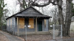 In this Jan. 16, 2017 photo, the abandoned childhood home of singer Aretha Franklin sits behind a security fence in Memphis, Tenn. (AP Photo/Mark Humphrey)