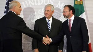 U.S. Secretary of State Rex Tillerson, centre, watches as Homeland Security Secretary John Kelly, left, shakes hands with Mexico's Foreign Secretary Luis Videgaray, on Feb. 23, 2017. (Carlos Barria/Pool Photo via AP)