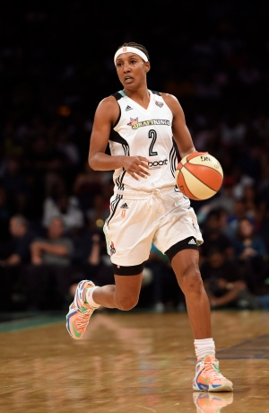 In this July 16, 2015, file photo, New York Liberty guard Candice Wiggins brings the ball up during the team's WNBA basketball game against the Connecticut Sun in New York. (AP Photo/Kathy Kmonicek, File)