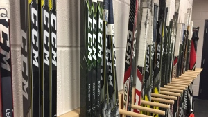 Saskatoon Blades players' sticks line a wall inside the SaskTel Centre. (Pat McKay/CTV Saskatoon)