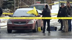 CPS members at the scene of Thursday morning's homicide near the intersection of 12 Avenue and Centre Street N.