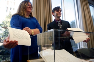 Museum Deputy CEO Angela Williams and University of Victoria's department of history Dr. John Lutz hold the the first-ever translation of the Douglas Treaties at the Royal BC Museum Archives building in Victoria, B.C. Thursday, February 23, 2017. (Chad Hipolito / THE CANADIAN PRESS)