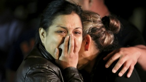 The mother of 18-year-old Subway employee Javier Flores cries with family and friends at the vigil prepared for Flores in Houston on Thursday, Feb. 23, 2017. (Yi-Chin Lee / Houston Chronicle)