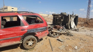 This image released by the Thiqa News Agency, damaged cars after a suicide attacker blew his small pick-up truck outside a security office in Sousian village, about 8 kilometres north of al-Bab, Friday, Feb. 24, 2017. (Thiqa News Agency, via AP)