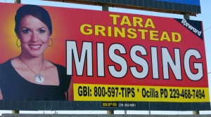 The Wednesday, Oct. 4, 2006, file photo of missing teacher Tara Grinstead is prominently displayed on a billboard in Ocilla, Ga. (AP Photo/Elliott Minor, File)