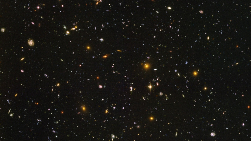 This image made by the NASA/ESA Hubble Space Telescope shows nearly 10,000 galaxies in the deepest visible-light image of the cosmos, cutting across billions of light-years. (NASA, ESA, S. Beckwith (STScI), HUDF Team)