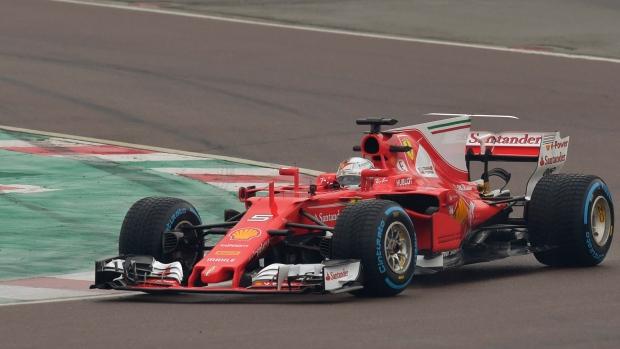 Sebastian Vettel and Kimi Raikkonen unveil new vehicle — Ferrari