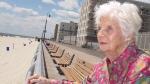 In this July 22, 2015 photo, Lucille Horn stands on the boardwalk outside her home in Long Beach, N.Y. (AP Photo/Frank Eltman)