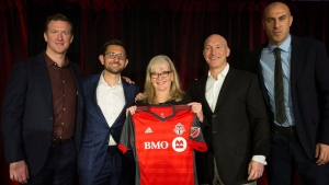 Toronto FC president Bill Manning, centre right, and general manager Tim Bezbatchenko, centre left, are joined by Connie Stefankiewicz, and former players Steven Caldwell, left, and Danny Dichio as they unveil the team's new shirt for the forthcoming season in Toronto on February 24, 2017. (Chris Young/The Canadian Press)