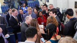 Reporters line up in hopes of attending a briefing in Press Secretary Sean Spicer's office at the White House in Washington, on Friday, Feb. 24, 2017. (AP Photo/Pablo Martinez Monsivais)