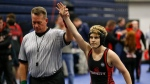 In this Feb. 18, 2017 photo, Euless Trinity's Mack Beggs is announced as the winner of a semifinal match after Beggs pinned Grand Prairie's Kailyn Clay during the finals of the UIL Region 2-6A wrestling tournament at Allen High School in Allen, Texas. (Nathan Hunsinger / The Dallas Morning News via AP)