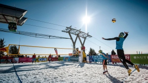 In this March 2016 photo released by Chaka2 GmbH, Austria's Michael Leeb, serving, and Florian Schnetzer face off against Poland's Michal Matyja and Rafal Matusiak, far court, during a snow volleyball match in Wagrain-Kleinarl, Austria. (Thomas Leskoschek / Chaka2 GmbH via AP)
